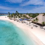 segara_PR_Agentur_München_Emerald_Maldives_aerial_view_couple_at_beach