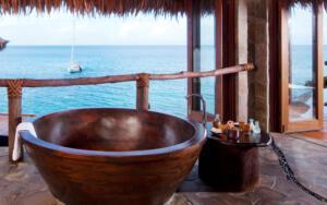Laucala_Island_overwater_villa_bathroom_bathtub