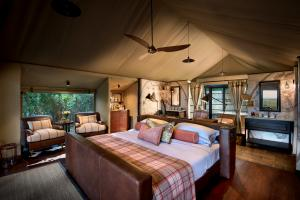 andBeyond Bateleur Camp Guest Room