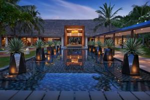 AVANI Quy Nhon  Exterior Lobby and Water Features at Dusk