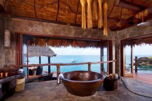Laucala Island overwater villa bathroom 2