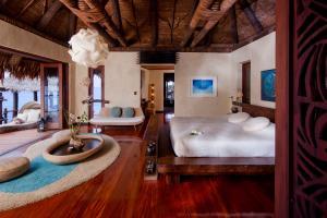 Laucala Island overwater villa bedroom
