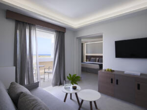 Neptune Hotels Resort Convention Centre & Spa Deluxe Family Room Living