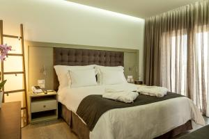 Neptune Hotels Resort Convention Centre and Spa  Zimmer Bett