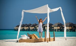 The Sun Siyam Iru Fushi Girl Beach